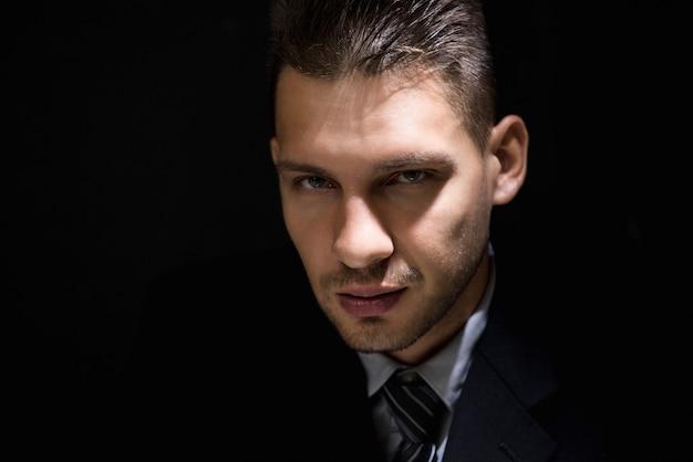 Tricky sly man face in dark room Premium Photo