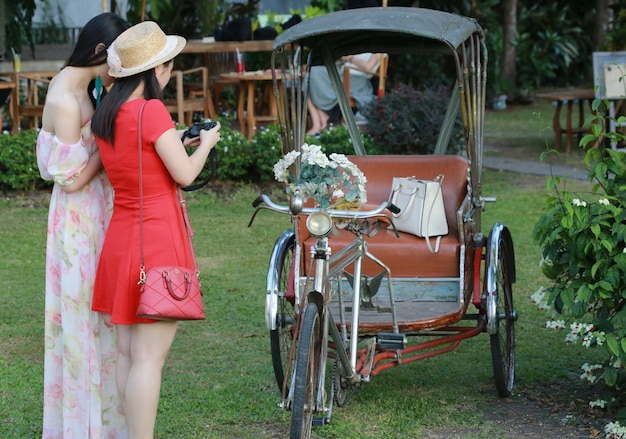 Tricycle with women , chiang mai, thailand Premium Photo