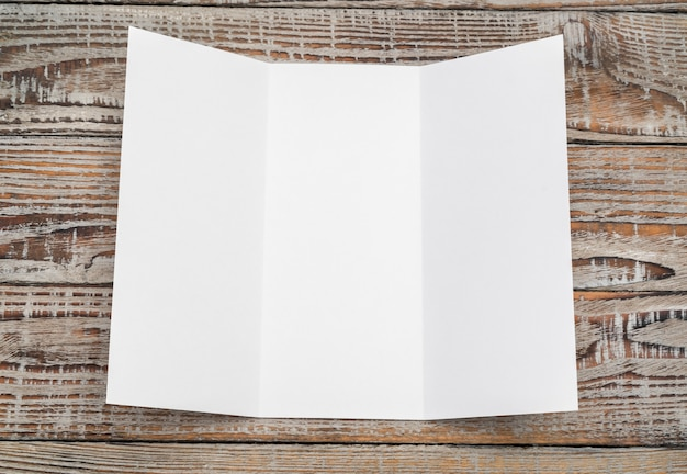 Trifold white template paper on wood texture . Free Photo