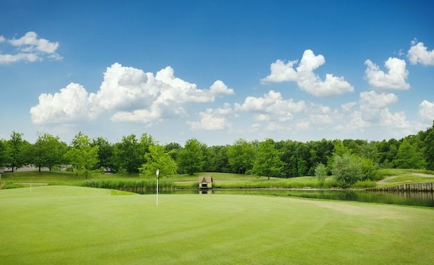 Trimmed field and sand bunkers on golf course Premium Photo
