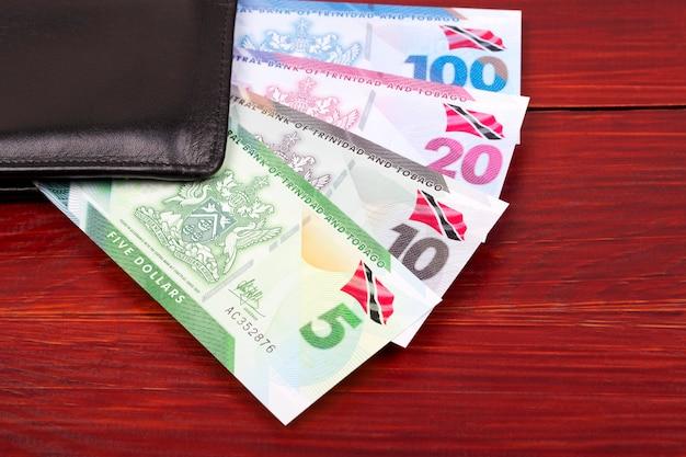 Trinidad and tobago dollar banknote in the black wallet Premium Photo