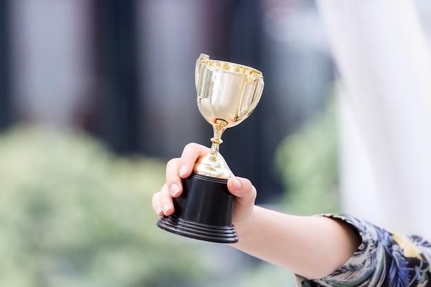 Trophy in lady's hands Premium Photo