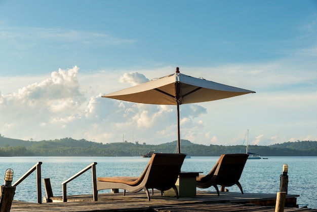 Tropical beach resort with lounge chairs and umbrellas in phuket ,thailand. Premium Photo
