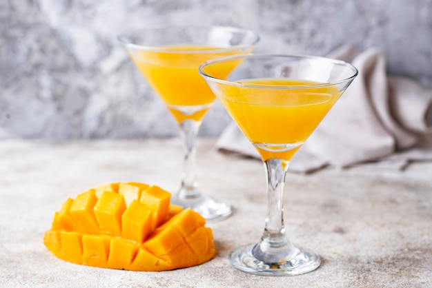 Tropical cocktail with mango on light background Premium Photo