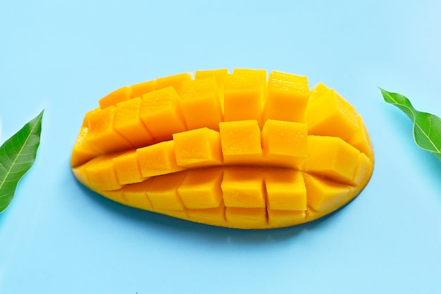 Tropical fruit, mango on blue table. top view Premium Photo