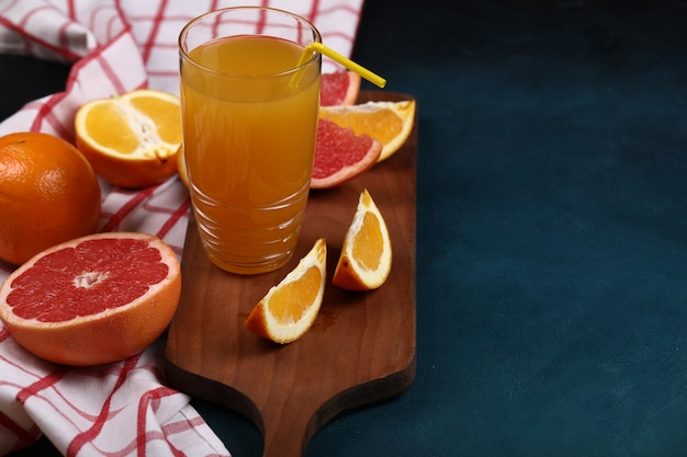 Tropical fruits with a glass of orange juice. Free Photo