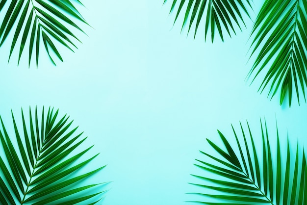 Tropical palm leaves. minimal summer concept. top view green leaf on punchy pastel paper Premium Photo
