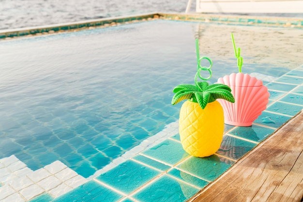 Tropical summer drinks beside the swimming pool Premium Photo