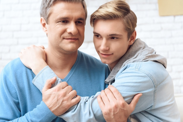 Troubled teenager is feeling attached his father. Premium Photo