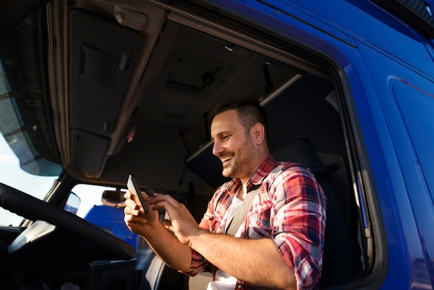 Truck driver using tablet for gps navigation to the destination Free Photo