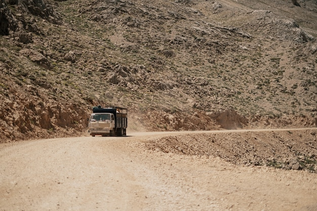 Truck driving on mountain road Free Photo