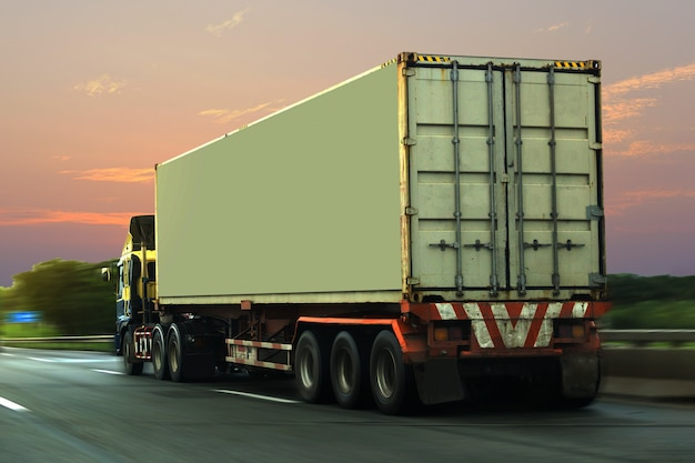 Truck on highway road with container, logistic industrial transporting land transport Premium Photo