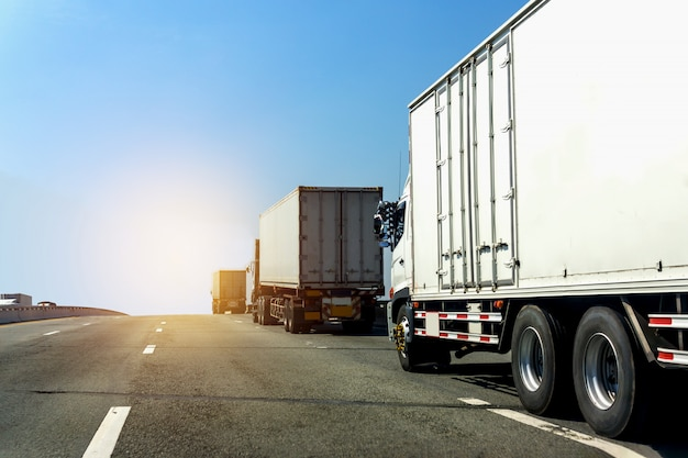 Truck on highway road with container,logistic industrial with blue sky Premium Photo