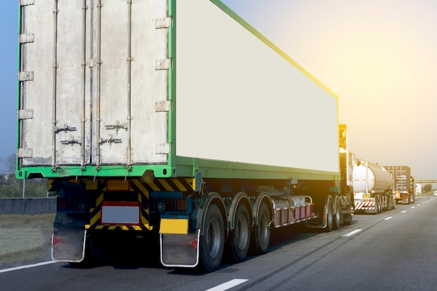 Truck on highway road with container Premium Photo
