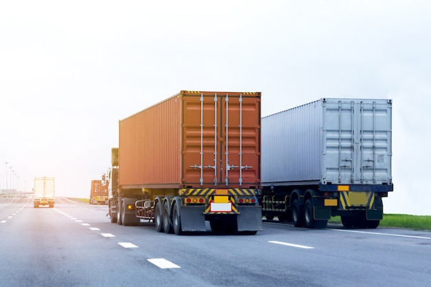 Truck on highway road with red container, import, export logistic industrial transport Premium Photo