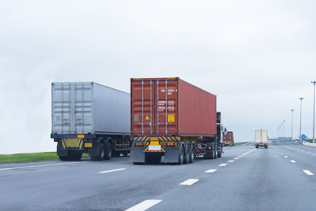 Truck on highway road with red container,import,export logistic industrial Premium Photo