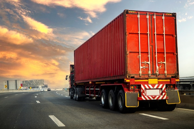 Truck on highway road with red container, transportation concept.,import,export logistic industrial transporting Premium Photo