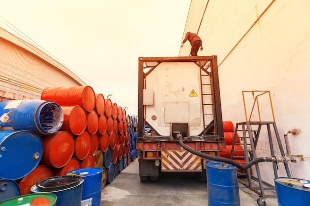 Truck hoses for fuel station, pumps and oil barrels Premium Photo