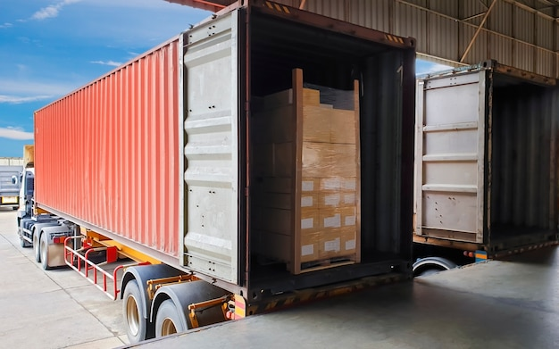 The truck trailer container docking load shipment goods pallets at warehouse, freight industry logis