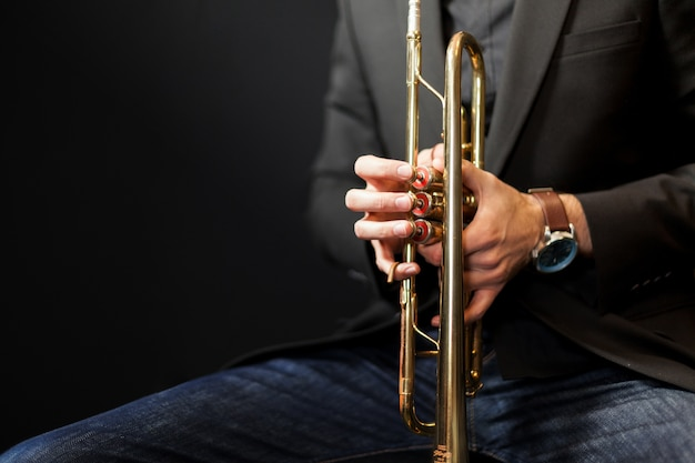 Trumpet player close up Free Photo