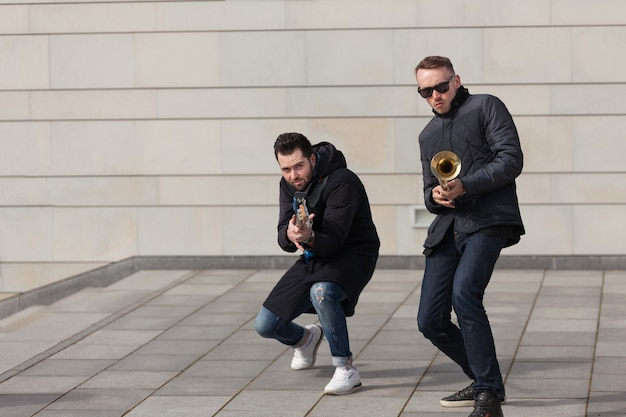 Trumpet player and guitarist fooling Free Photo