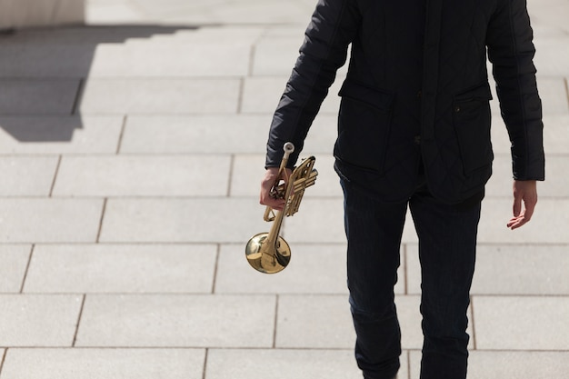 Trumpet player outdoors Free Photo