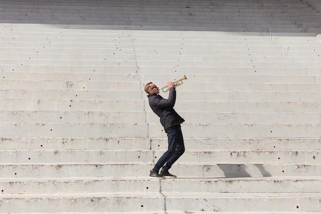Trumpet player in stadium Premium Photo