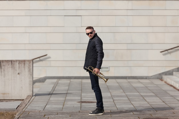 Trumpet player in urban environment Free Photo