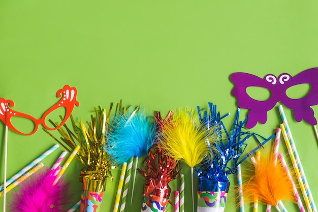 Trumpets with serpentine, colored sticks and colored masks Free Photo