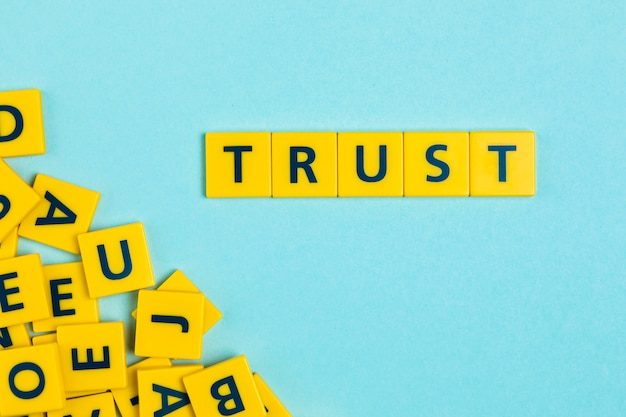 Trust word on scrabble tiles Free Photo