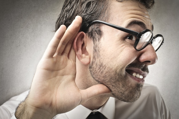 Trying to hear Premium Photo