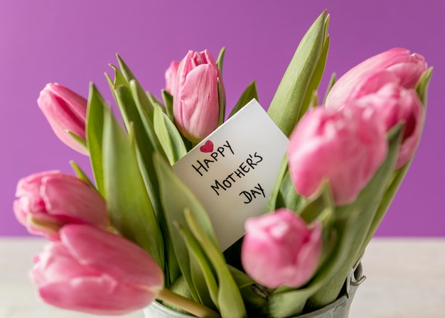 Tulips arrangement with card Free Photo
