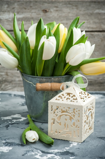 Tulips and a gift package Premium Photo