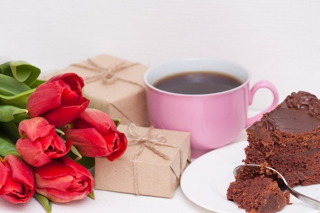 Tulips, presents, cake, cup for mother, wife, daughter, girl with love. happy birthday, Premium Photo