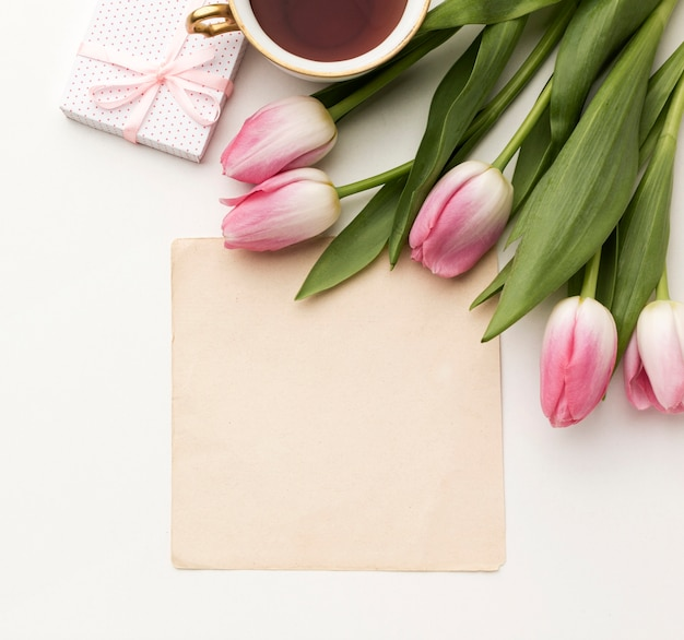 Tulips with gift and greeting card Free Photo