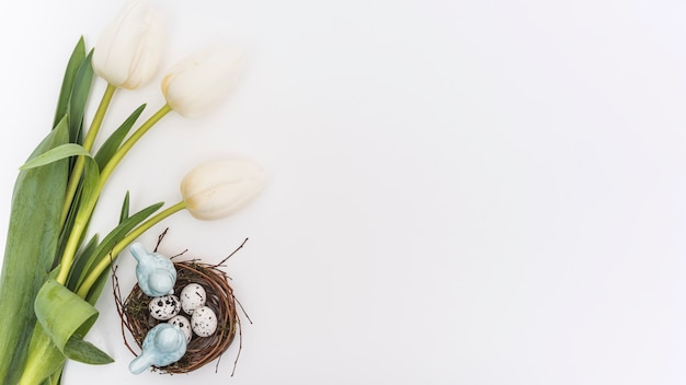 Tulips with quail eggs in nest Free Photo