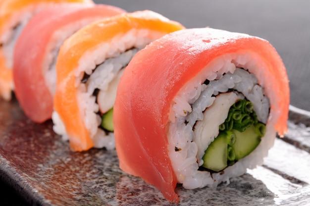 Tuna sushi roll close up Free Photo