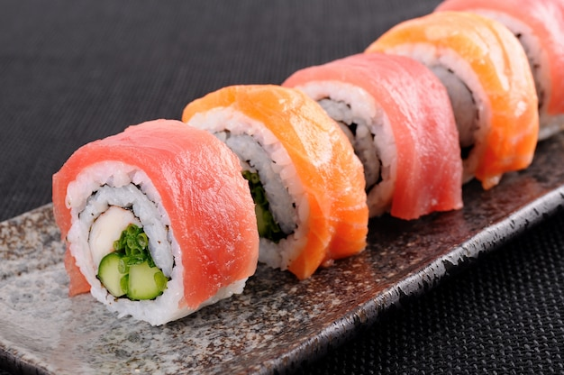 Tuna sushi roll on a plate Free Photo