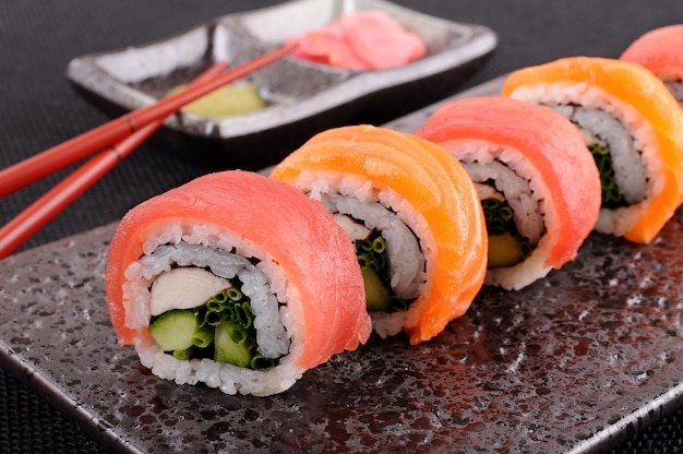 Tuna sushi roll with chopsticks Free Photo