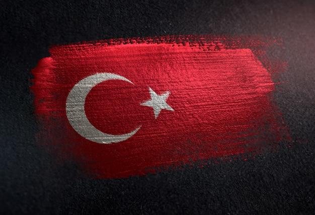Turkey flag made of metallic brush paint on grunge dark wall Premium Photo