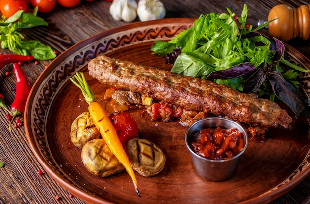 Premium Photo Turkish And Arabic Traditional Mix Kebab Plate Kebab Lamb And Beef With Baked Vegetables Mushrooms And Tomato Sauce