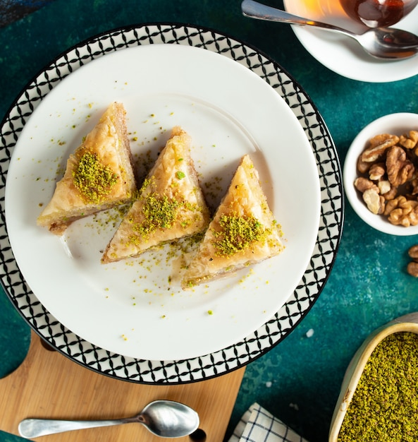 Turkish baklava in the plate top view Free Photo
