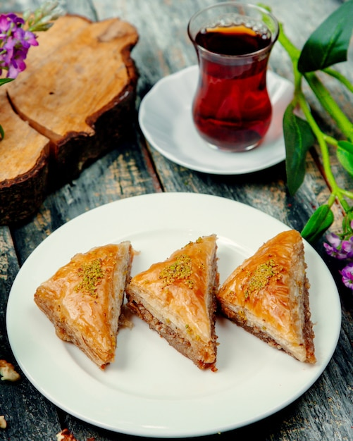 Turkish baklava with nuts and a cup of hot tea Free Photo
