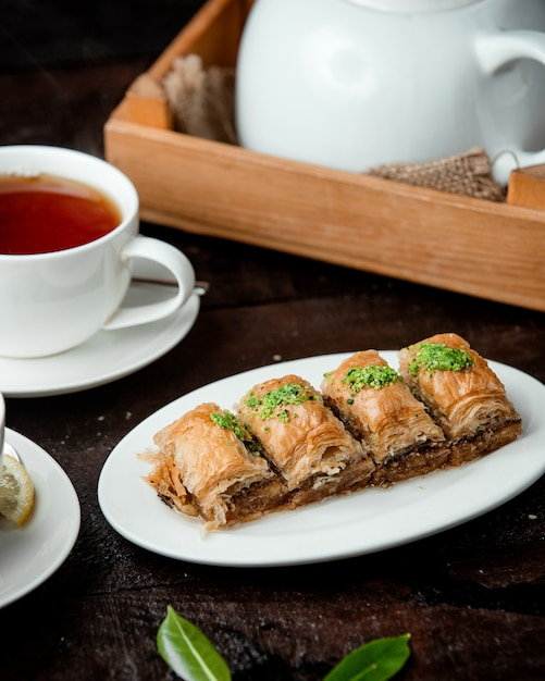 Turkish baklava with nuts and fragrant tea Free Photo