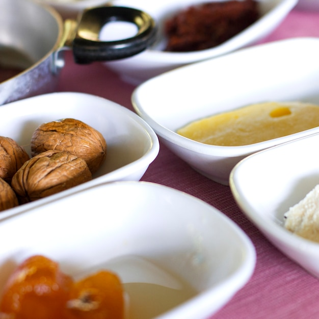 Turkish breakfast. large walnuts, orange jam, butter Premium Photo