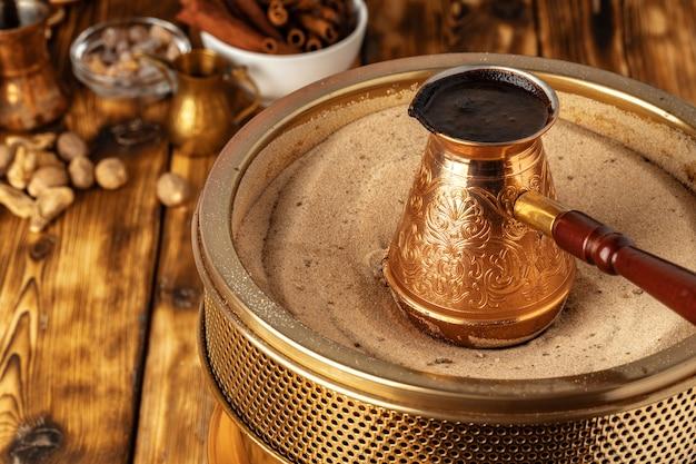 Premium Photo | Turkish coffee in cezve on the sand