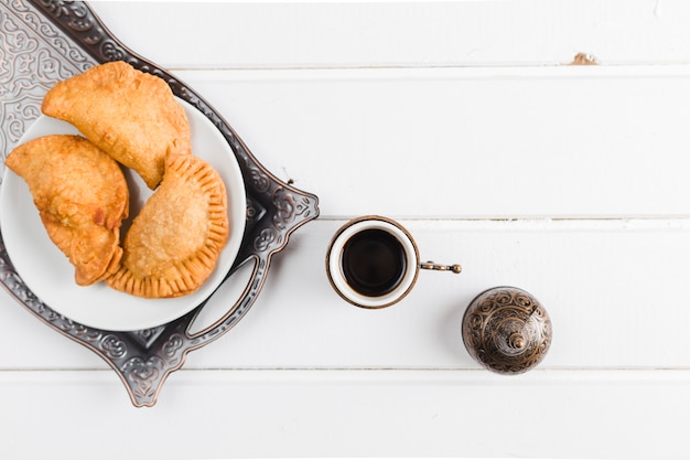 Turkish coffee and pasties on tray Free Photo
