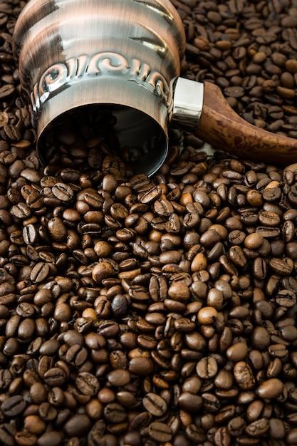 Turkish coffee pot and coffee beans Premium Photo