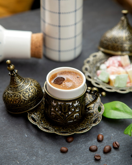 Turkish coffee served in ornated cup Free Photo