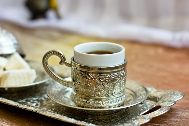 Turkish coffee and turkish sweets lokum on metal tray Premium Photo